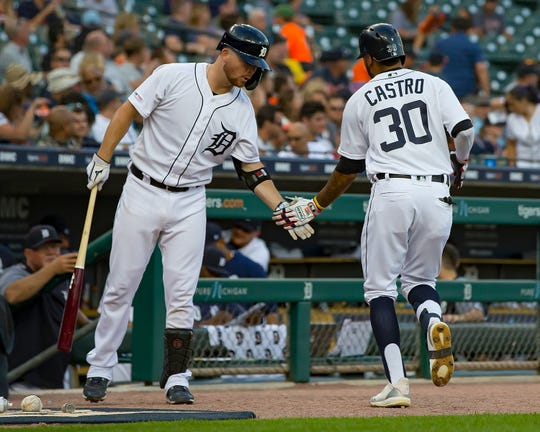 Tigers left fielder Harold Castro celebrates with catcher Jake Rogers after hitting a three-run home run in the second inning on Thursday, Aug. 8, 2019, at Comerica Park.