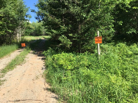 An entrance to the property where Aquila Resources plans a 750-foot-deep pit mine.