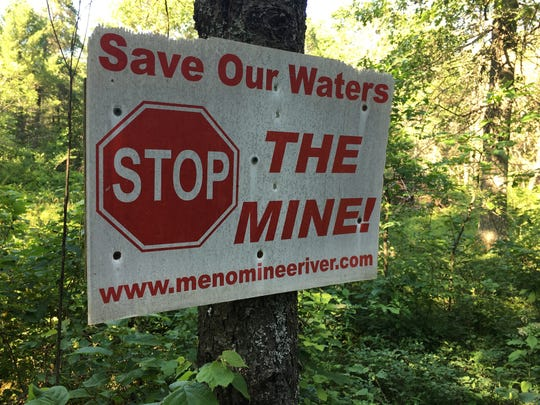A sign expresses a property owner's opposition to Aquila Resources' plan to open a pit mine near the Menominee River in Michigan.