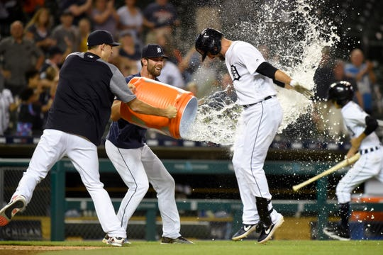 Detroit Tigers pitchers Matthew Boyd, left, and Daniel Norris throw water onto Jordy Mercer after he hit the game-winning two-run home run against the Kansas City Royals in the ninth inning of a baseball game Thursday, Aug. 8, 2019, in Detroit. The Tigers won 10-8.