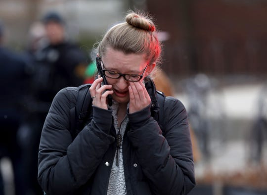 Monika Paliwoda wipes away tears after leaving a building on campus near the Diag at the University of Michigan in Ann Arbor on Saturday, March 16, 2019. Paliwoda was in the building as police assessed the threat of an alleged shooter. They later determined that it was a false alarm after doing a room-by-room, floor-by-floor search and the all clear was given.