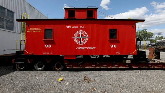 A Detroit Toledo and Ironton DT&I center cupola caboose built in 1924 and restored recently, sits in a yard in Roseville, Michigan on Friday, August, 9, 2019. 