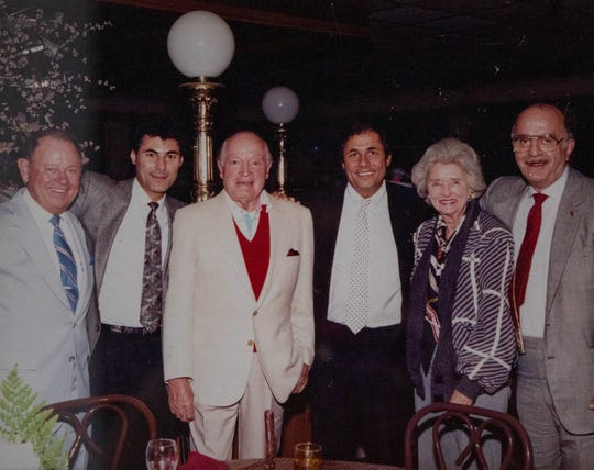 Comedian Bob Hope dined at Ginopolis' in Farmington Hills in 1990. Posing after dinner, from left, are Harry Adler (a friend of Hope), Peter Ginopolis,  Hope, Johnny Ginopolis, Dolores Hope and Ted Gregory (Marion Ginopolis' uncle).