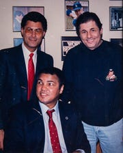 Peter Ginopolis (left), Muhammad Ali and Johnny Ginopolis pose in 1990 at Ginopolis' restaurant in Farmington Hills.