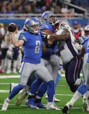 Lions quarterback Davis Fales is sacked by Patriots defensive lineman Nick Thurman during the second half of the Lions' 31-3 preseason loss to the Patriots on Thursday, Aug. 8, 2019, at Ford Field.