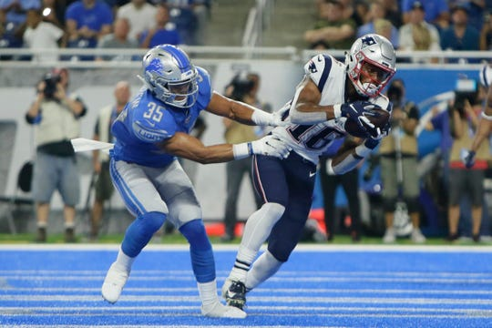 New England Patriots receiver Jakobi Meyers, defended by Detroit Lions defensive back Miles Killebrew (35), catches a touchdown pass during the first half.