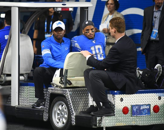 Lions wide receiver Jermaine Kearse is taken off the field after suffering a leg injury in the first quarter on Thursday.
