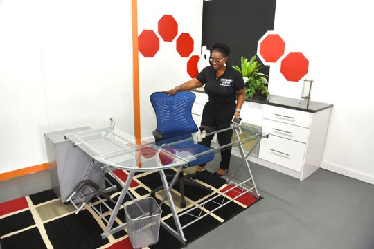 Dr. Theresa Edwards, chief operations officer for  Detroit Cabinet Manufacturing, shows off one of many office and meeting areas at the SpaceLab 7Mile co-working space.