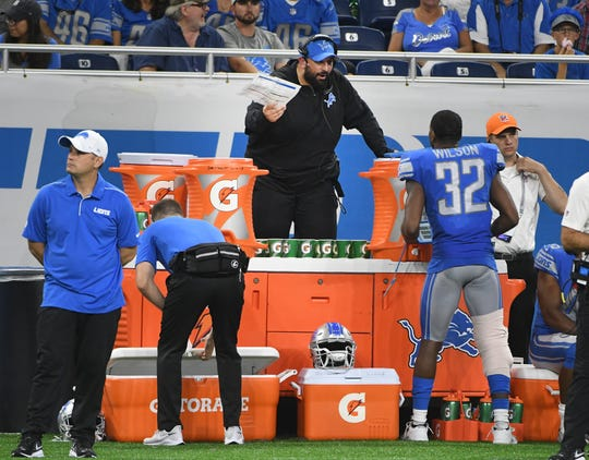 Lions coach Matt Patricia watched Thursday's preseason opener from the sidelines behind a wall of Gatorade for safety due to his leg injury.