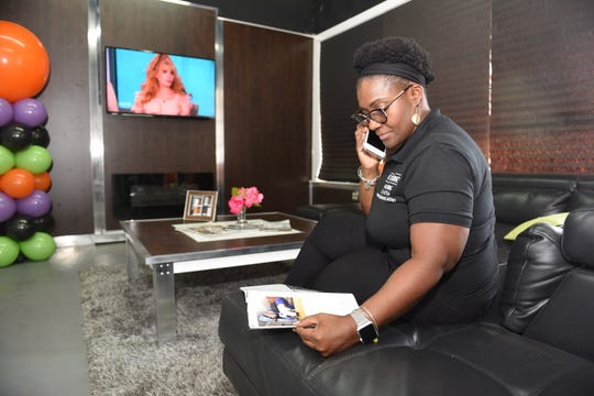 Dr. Theresa Edwards, chief operations officer for Detroit Cabinet Manufacturing, answers a call at the office and meeting area at the SpaceLab 7Mile co-working space.