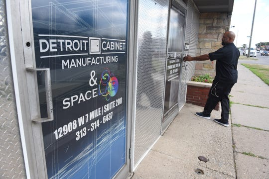 Deon Harper, quality control, Detroit Cabinet Manufacturing, enters the co-working space that houses the cabinet company and the SpaceLab 7Mile co-working space.