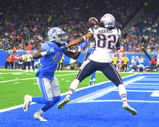 Patriots wide receiver Maurice Harris catches a touchdown pass in front of Lions cornerback Amani Oruwariye in the first quarter of Thursday's preseason opener.