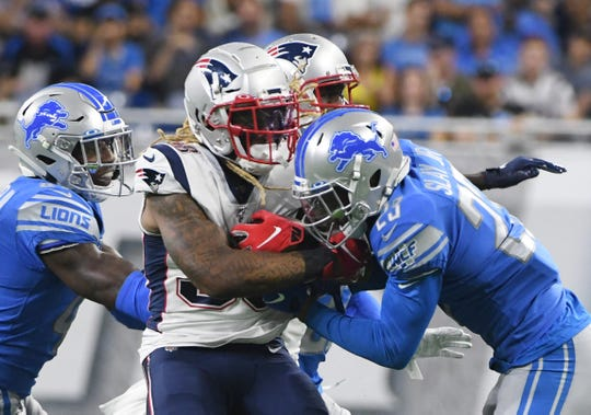 Lions cornerback Darius Slay brings down Patriots' Brandon Bolden in the first quarter of Thursday's preseason opener.