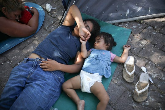 In this Aug. 1, 2019, photo, migrants rest near a Mexican immigration center where migrants set up camp in Matamoros, Mexico. Turning Mexican border cities into waiting rooms for asylum seekers may be the Trump administration's most forceful response yet to a surge of migrants, many of them Central American families.