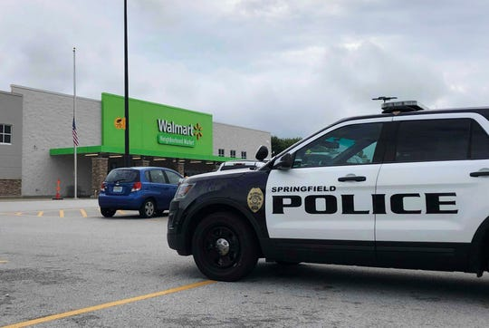 Springfield police respond to a Walmart in Springfield, Mo., Thursday afternoon, Aug. 8, 2019, after reports of a man with a weapon in the store.