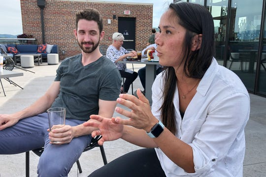 Marco Teeter and Katherine Schaffer speaks at a rooftop bar at The Bristol Hotel in Bristol, Va. Ten medical students were on a tour of the city organized by a medical school with the aim of luring them to practice in rural communities facing health care shortages after graduation.