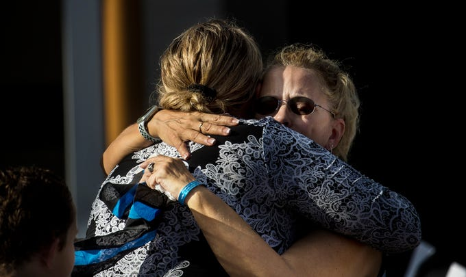 Debra Neri, right, the wife of fallen Sanibel Island police officer, Anthony Neri gets embraced by Sanibel police Lt. Grace Towler at a Fallen Officer memorial ceremony at the Southwest Florida Public Service Academy in Fort Myers on Friday August, 8, 2019. Neri died of natural causes during a training drill in May of this year. A brick was added during the ceremony at the academy.