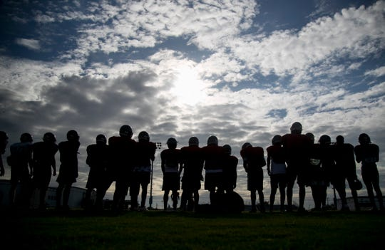 South Fort Myers football players line up for an early August morning practice.