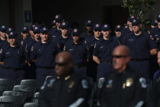 About a 100 people gathered for a Fallen Officer memorial ceremony honoring Sanibel police officer Anthony Neri at the Southwest Florida Public Service Academy in Fort Myers on Friday August, 8, 2019. Neri died of natural causes during a training drill in May of this year.