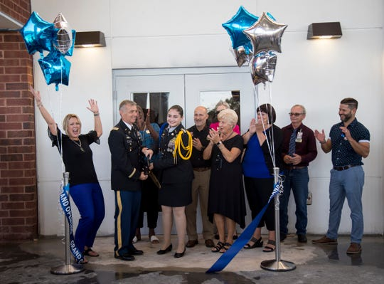 Lehigh Senior High School principal Jackie Corey, JROTC teachers, Lee County School Board members and superintendent Greg Adkins celebrate the grand opening of the high school's new building on Friday, August 9, 2019, in Lehigh Acres. The building will house the JROTC and social studies departments.