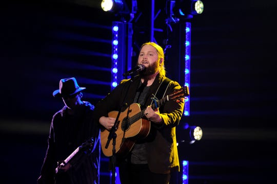 "Chris Kroeze, shown performing on NBC's ""The Voice,"" will bring his country-rock sound to Wisconsin Rapids for a concert on Feb. 6."