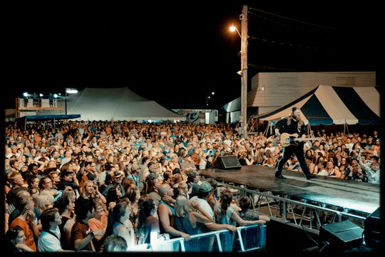 """The Voice"" runner-up Chris Kroeze walks the stage in front of several thousand fans in June at Aquafest in Rice Lake, where he headlined opening night."