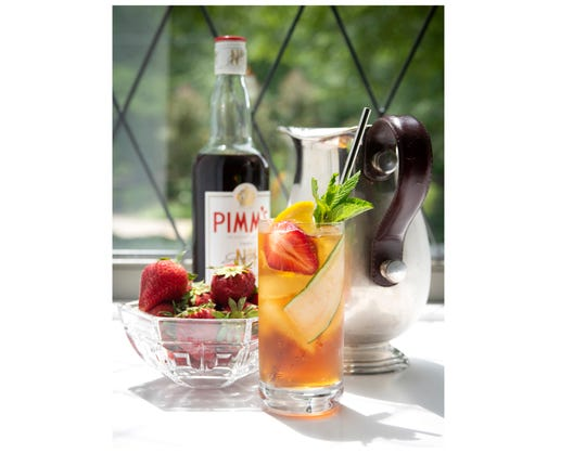 The Pimm's Pitcher with Pimm's No. 1, lemonade and fruit garnishments.