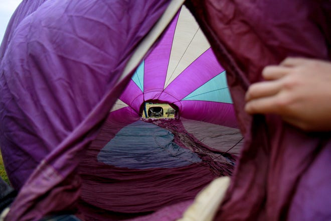 A look inside of John Phillip's 33-year-old hot air balloon while it was being inflated in Choteau, on Friday