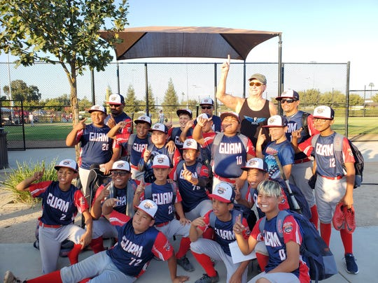 The Guam 12U All-Stars take a team photo after their big 10-5 win over Southwest to advance to the finals of the Iron Bracket at the 2019 Cal Ripken Major 60 World Series Championship in Visalia, California.