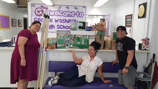 From left, Ashae Chargualaf, Pam Harris and Ron Castro, donated painting supplies to George Washington High School on Aug. 9 on behalf of the George Washington High School Class of 2009.