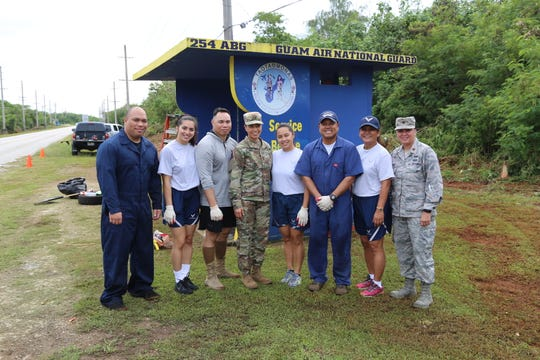"Airmen from the Guam Air National Guard, volunteered to help clean and prepare their adopted bus stop along Route 15 in Mangilao on Aug. 9. ""We want the kids to have a nice, safe place to wait for their bus,"" said Master Sgt. Randy Alegre, Noncommissioned Officer in Charge, 254th Air Base Group's Logistics Section."