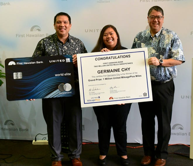 From left: Sam Shinohara, managing director of United Airlines; Germaine Chy, winner of 1 million miles; and Mitchell E. Nishimoto, vice chairman of retail banking group at First Hawaiian Bank.
