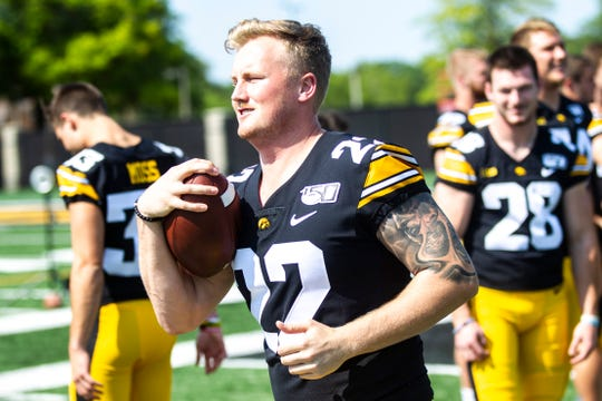 Iowa punter Michael Sleep-Dalton runs with a ball during Hawkeyes football media day, Friday, Aug. 9, 2019, at the University of Iowa outdoor practice facility in Iowa City, Iowa.