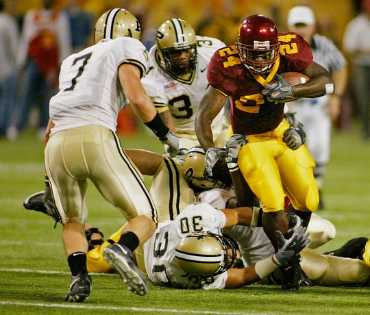 Kyle Williams, rear, chases down a Minnesota running back in his lone season at Purdue in 2005.
