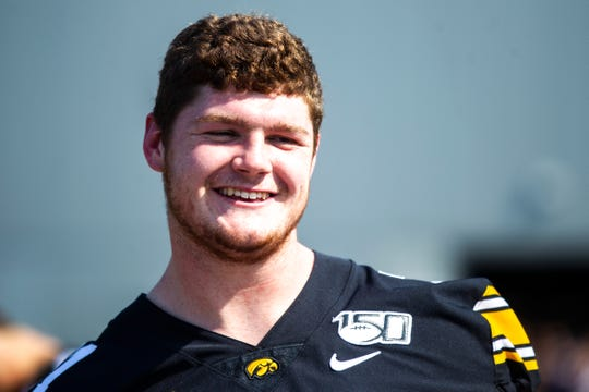 Iowa offensive lineman Mark Kallenberger smiles while talking with teammates during Hawkeyes football media day, Friday, Aug. 9, 2019, at the University of Iowa outdoor practice facility in Iowa City, Iowa.