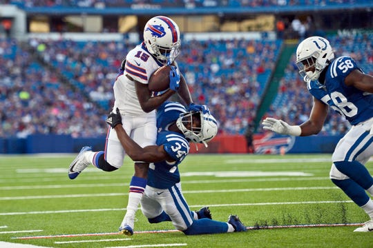 Indianapolis Colts' Rock Ya-Sin (34), center, tries to bring down Buffalo Bills' John Brown during the first half of an NFL preseason football game, Thursday, Aug. 8, 2019, in Orchard Park, N.Y.