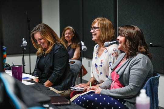 Freshemp podcasters and co-founders of CannaMedU, Pamela Trapp, left, Heather Beuke Diers, center, and Amy Nichols, right, record their Freshemp podcast at the Hamilton East Public Library in Fishers Ind. on Thursday, July 25, 2019. The trio founded the company to educate medical professionals and the public about CBD oil.