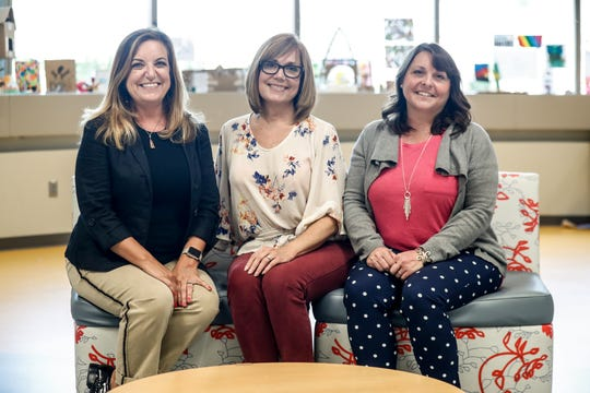 Freshemp podcasters and co-founders of CannaMedU, Pamela Trapp, left, Heather Beuke Diers, center, and Amy Nichols, right, are shown at the Hamilton East Public Library in Fishers Ind. where the trio records their podcast, on Thursday, July 25, 2019. The trio founded the company to educate medical professionals and the public about CBD oil.
