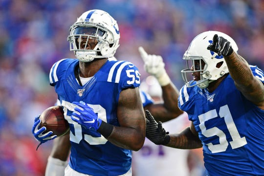 Indianapolis Colts' Carroll Phillips, left, celebrates with teammates after a turnover during the first half of an NFL preseason football game against the Buffalo Bills, Thursday, Aug. 8, 2019, in Orchard Park, N.Y.