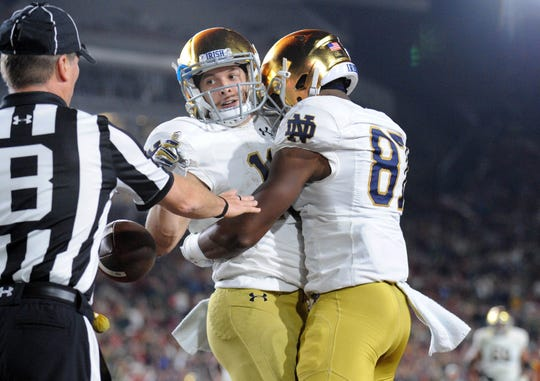 Notre Dame wide receiver Chris Finke (10) celebrates with wide receiver Miles Boykin (81) his touchdown scored against the Southern California Trojans during the first half at the Los Angeles Memorial Coliseum.