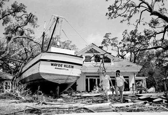 This is a Aug. 18, 1969 file photograph of an 85-foot boat that was deposited in the yard of Stafford Cooper in Biloxi, Miss., as part of the wreckage of Hurricane Camille. The boat's anchorage is more than 100 yards from the home and floated in on flood tides. Although it has been 50 years, since the Category 5 storm hit the Gulf Coast, Hurricane Camille is still one of the benchmarks by which all hurricanes are measured. (AP Photo/Joe Holloway Jr., File)