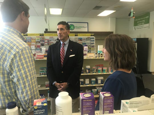 U.S. Congressman David Kustoff dicusses issues in healthcare with Dr. Matt Baker and his wife, Dr. Morgan Baker, who own Health Care Pharmacy in Jackson.