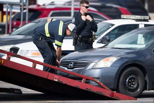 The car a child was found dead in outside a Food City on 5078 Clinton Highway, is towed away Friday, Aug. 9, 2019. The gender and age of the child were not immediately available.