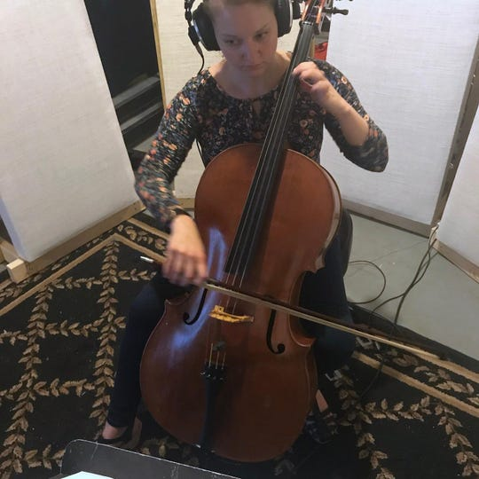 Kathryn York records a cello track for the band Gone in April in Knoxville, May 2019.