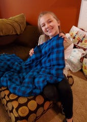 Avery Hanson works on a weighted blanket in Karns Friday, Aug. 2.