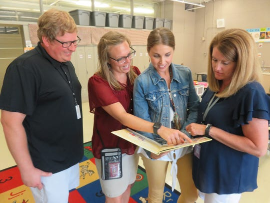 New Pond Gap Elementary principal Trina Bruns, second from left, enjoys a moment after school with her first-grade teachers – Chase Valentine, Angela Waskom and Missy Jones.