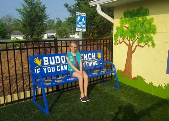 Avery Hanson installed a Buddy Bench at Karns Lions Club All Inclusive Playground in April 2017.
