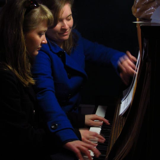 Kathryn York, left, plays piano with sister Elizabeth in North Carolina, Christmas 2013.