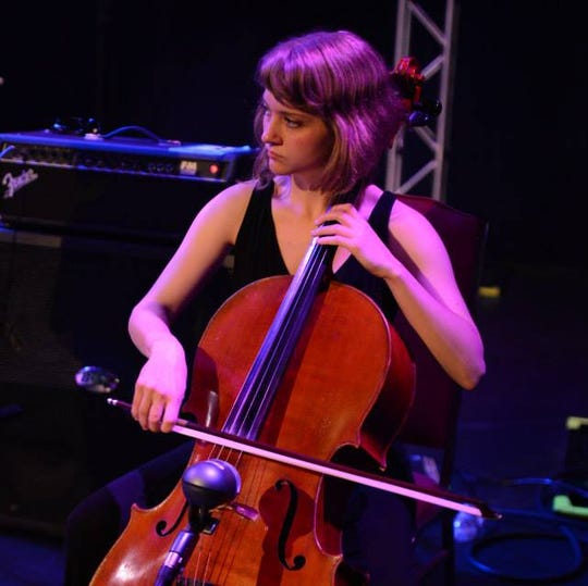 Kathryn York plays cello at the Bijou Theater, summer 2014.