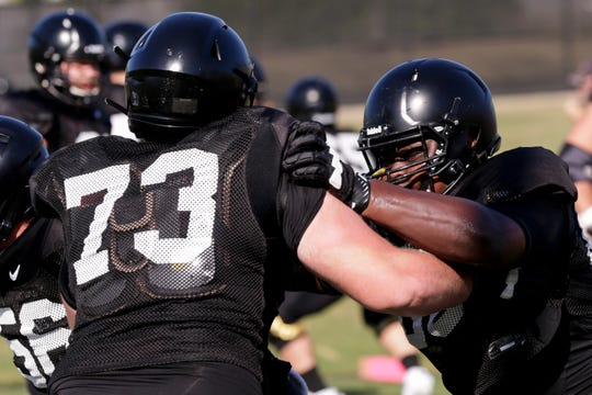 Purdue outside lineman Alex Criddle (66) blocks Purdue outside lineman Kyle Jornigan (73) during practice, Friday, Aug. 9, 2019 at Bimel Practice Complex in West Lafayette.